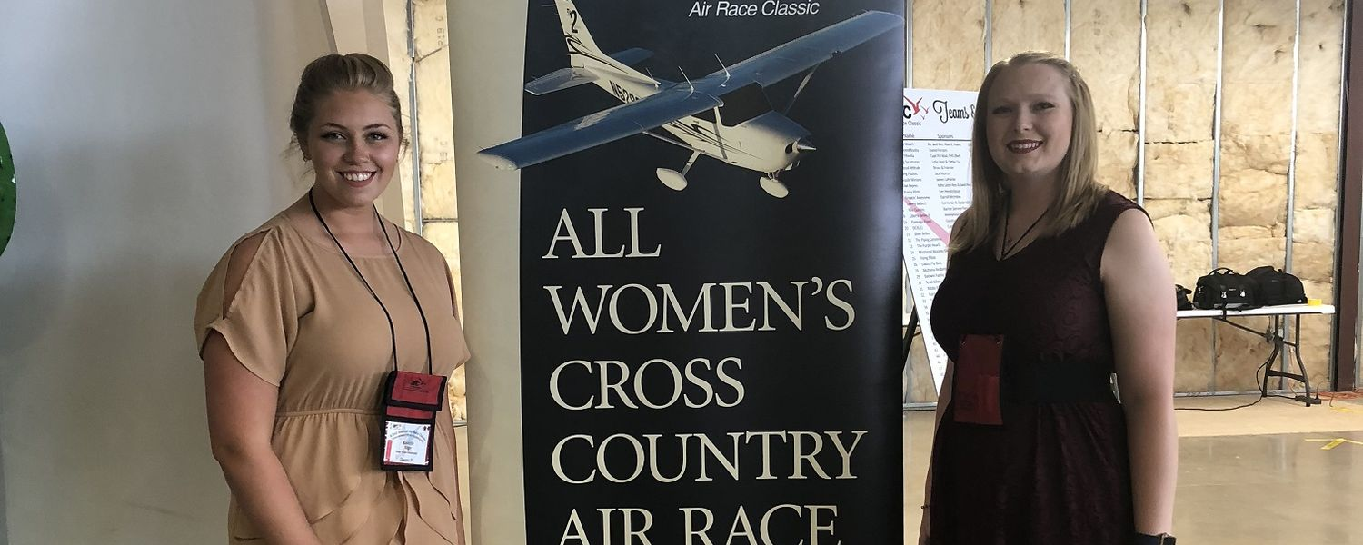 photo aeronautics students Helen Miller and Kenzie Alge pose at 2018 Air Race Classic gathering