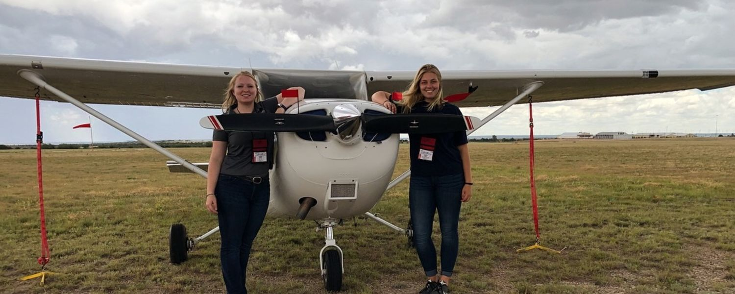 photo aeronautics students Helen Miller and Kenzie Alge pose with aircraft at 2018 Air Race Classic