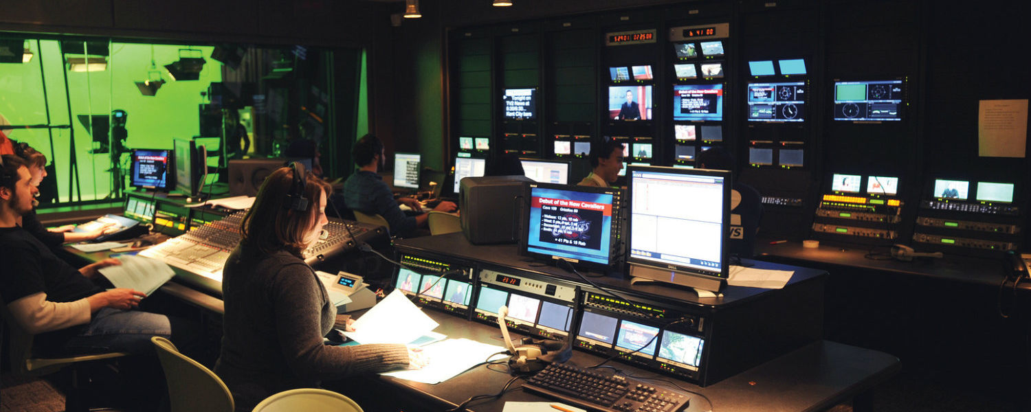 Students work in the TV2 production area in Franklin Hall during a live broadcast of the news.