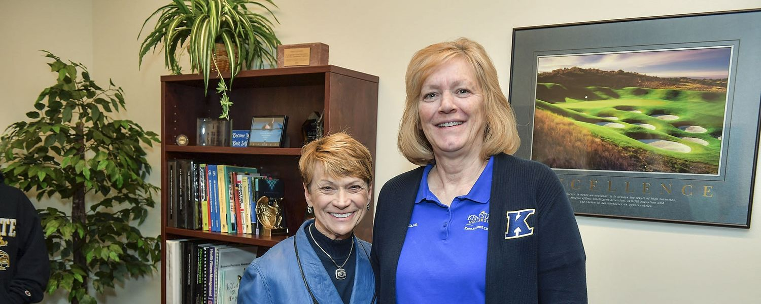 Kent State University President Beverly J. Warren presented seven Kent State staff members with the 2019 President's Award of Distinction. Here, Melissa Sink (right), housekeeping manager, receives a surprise visit from President Warren.