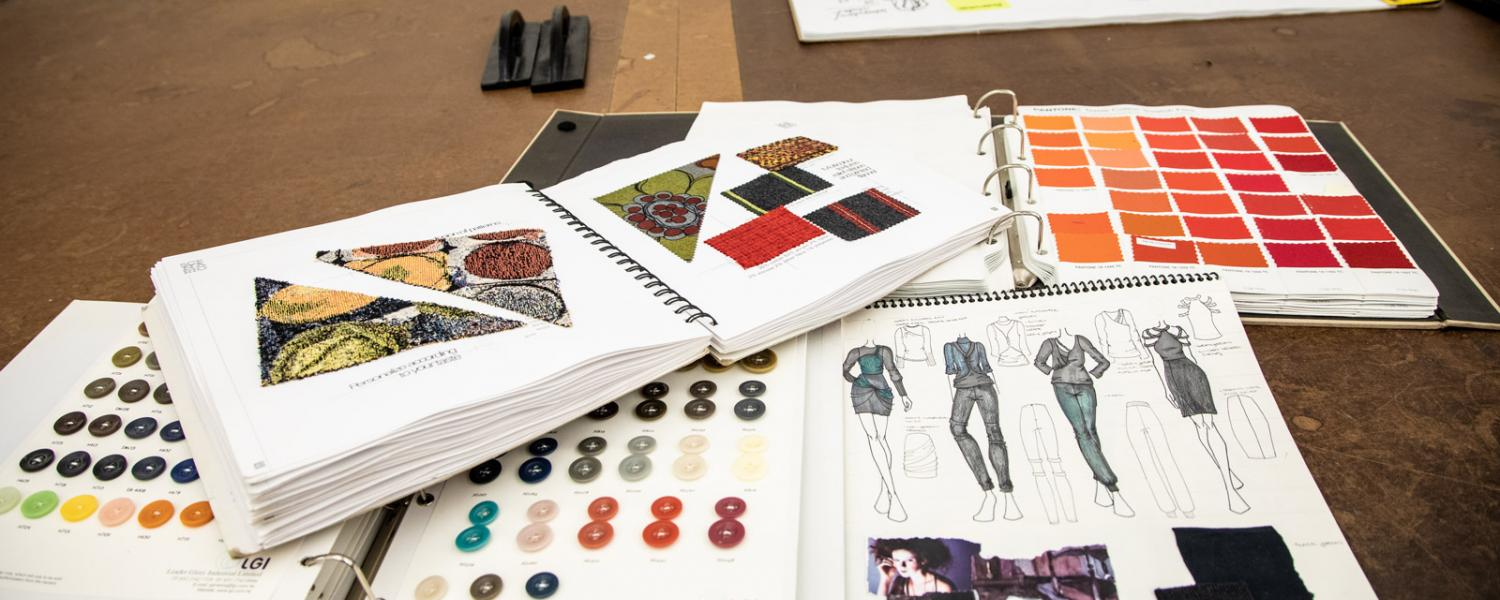Open swatch books and design sketches