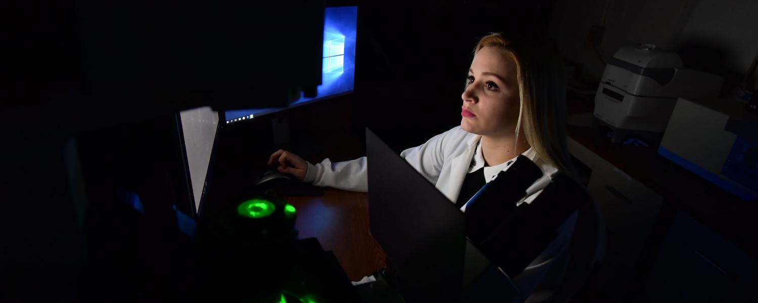 Kent State University student performing research in a Physics lab