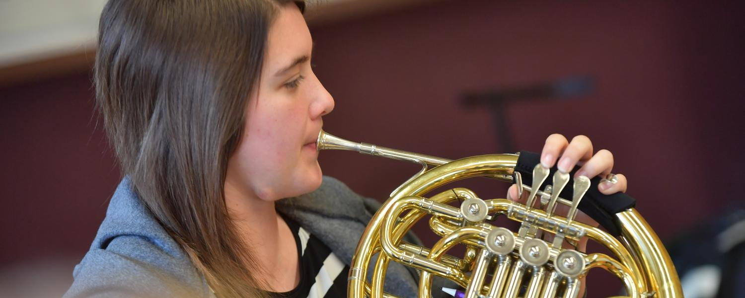 Student playing horn
