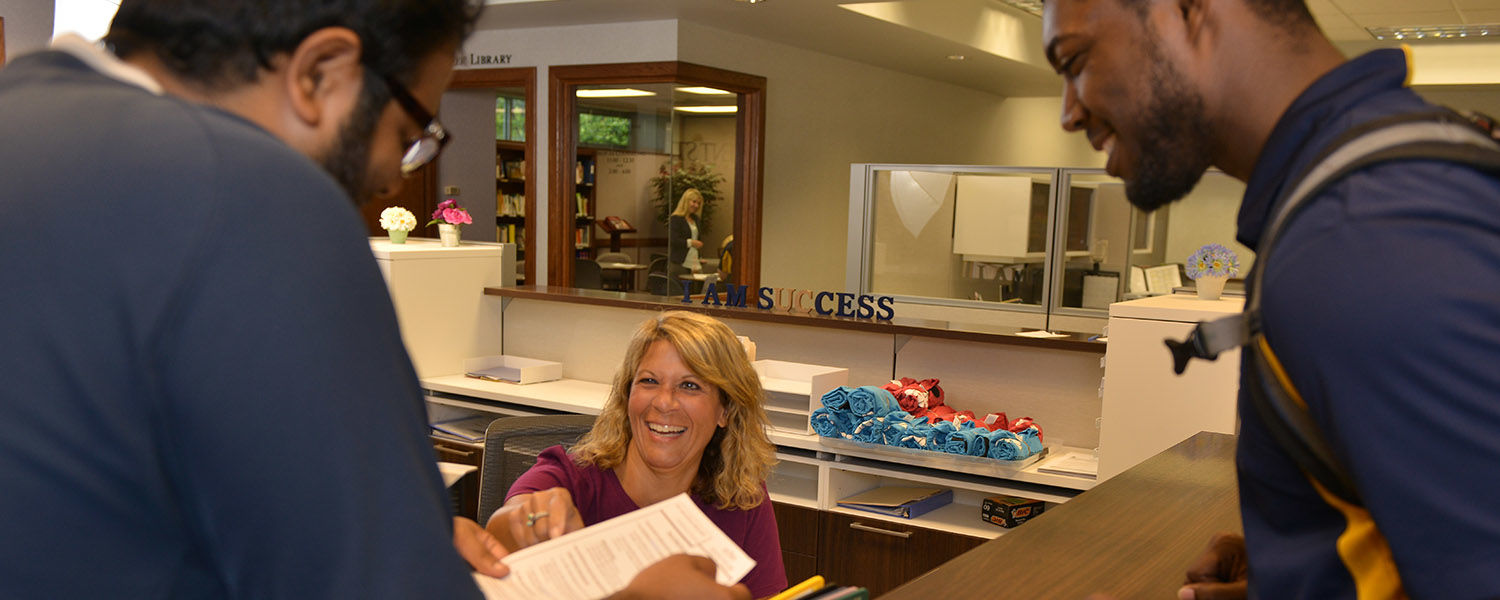 Students at front desk