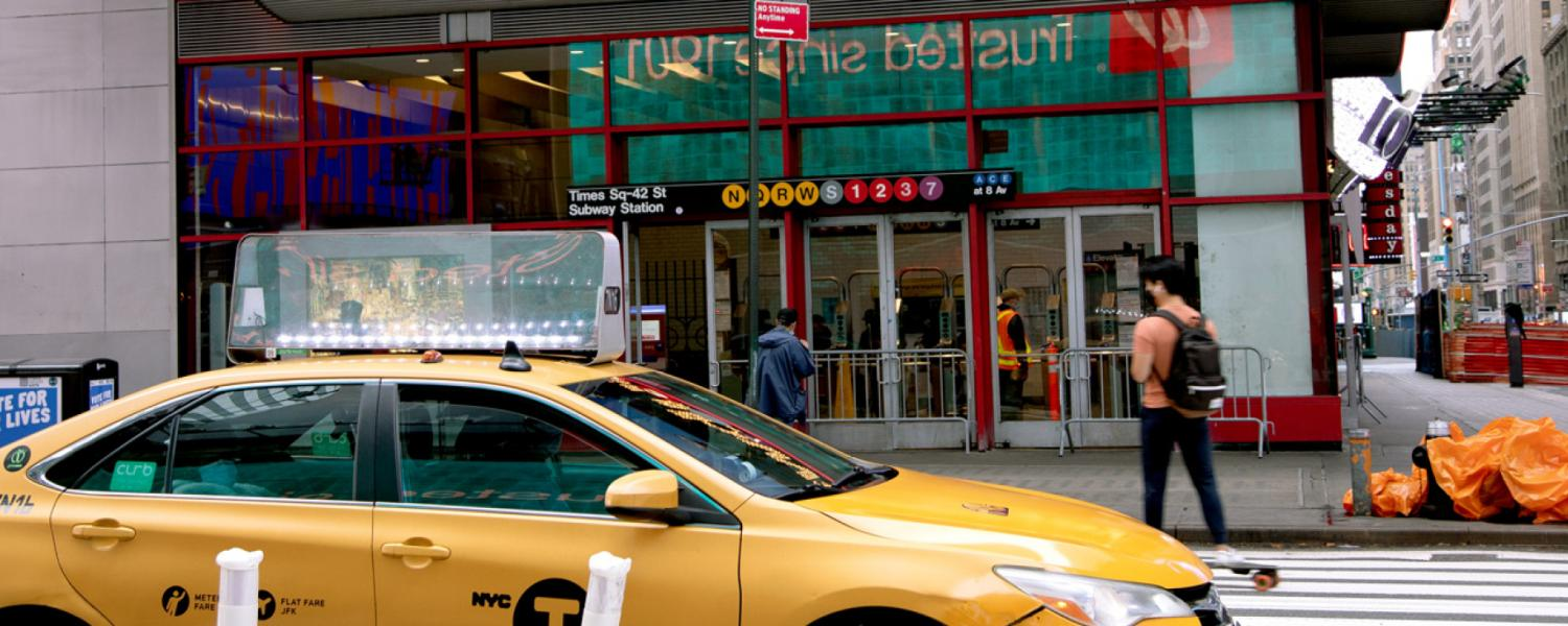 Taxi in front of Subway station