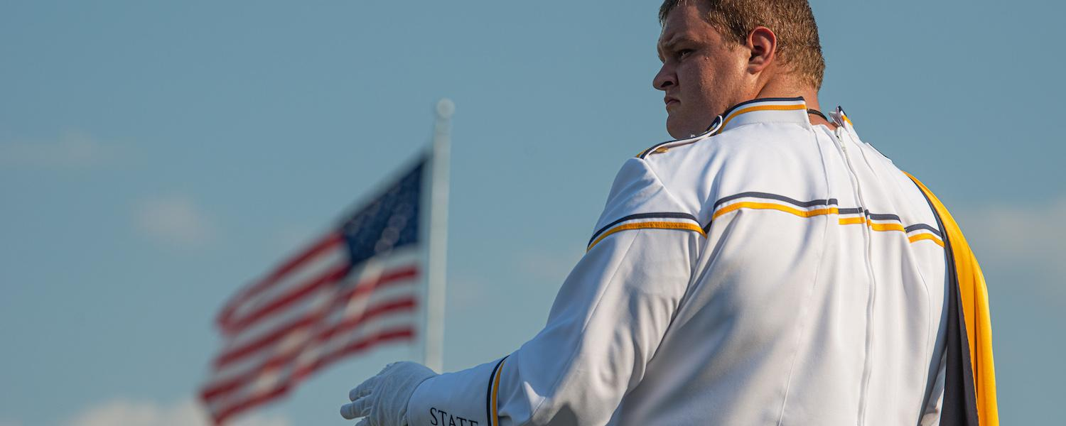 Drum Major leading Marching Golden Flashes