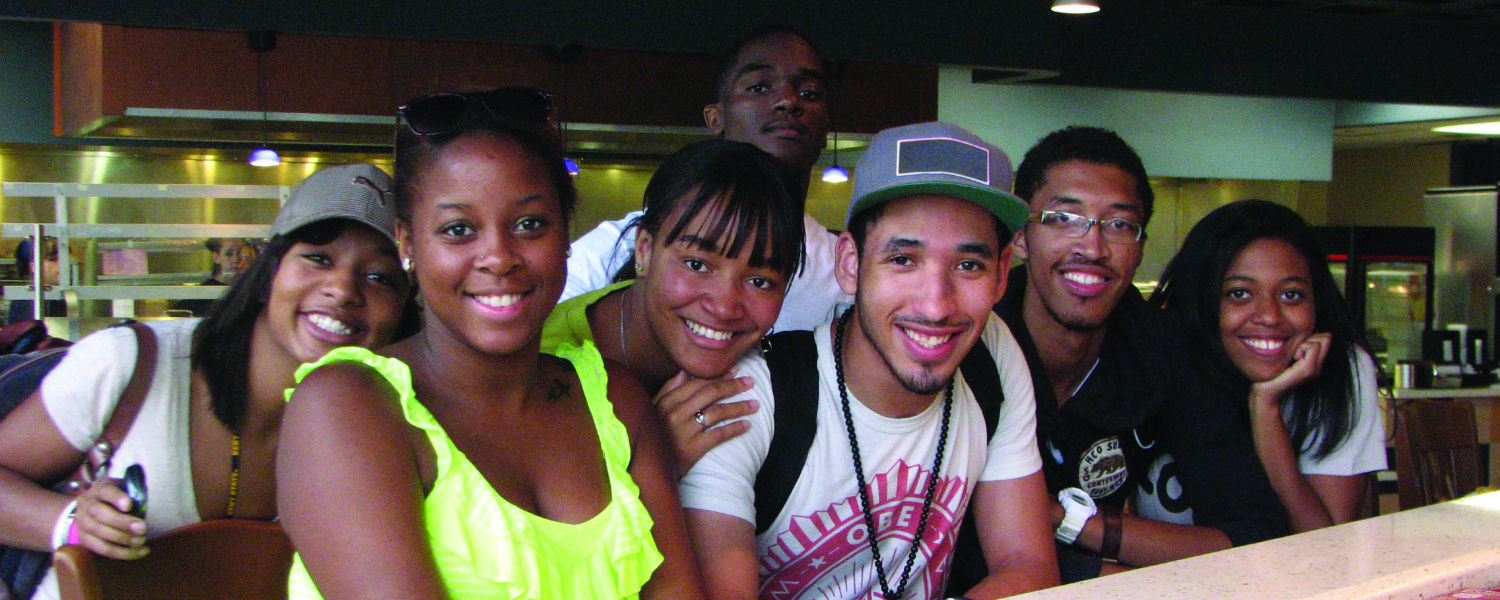 Students huddle together for a group photo in Rosie's Diner