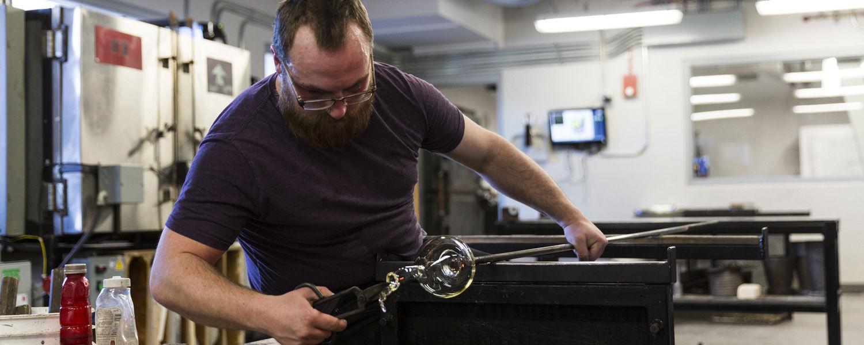 Glass Program - student working