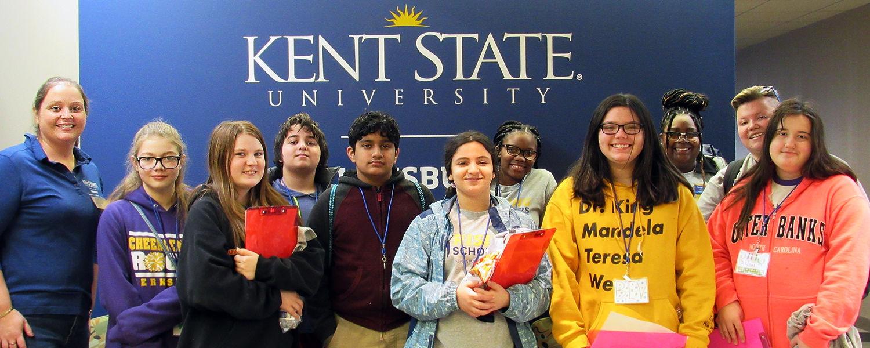 Rising Scholars program students standing next to mentors