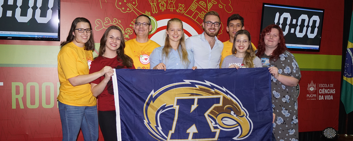 2016 Mission V Winning Team displays the Kent State banner at the International Competition in Brazil