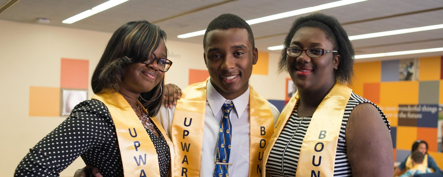 Three upward bound students pose for group photo.