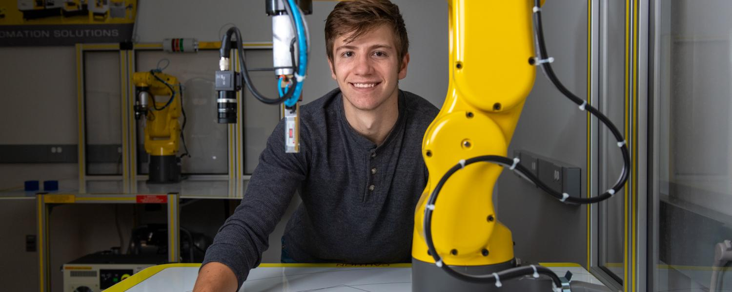Male Student with FANUC Robot