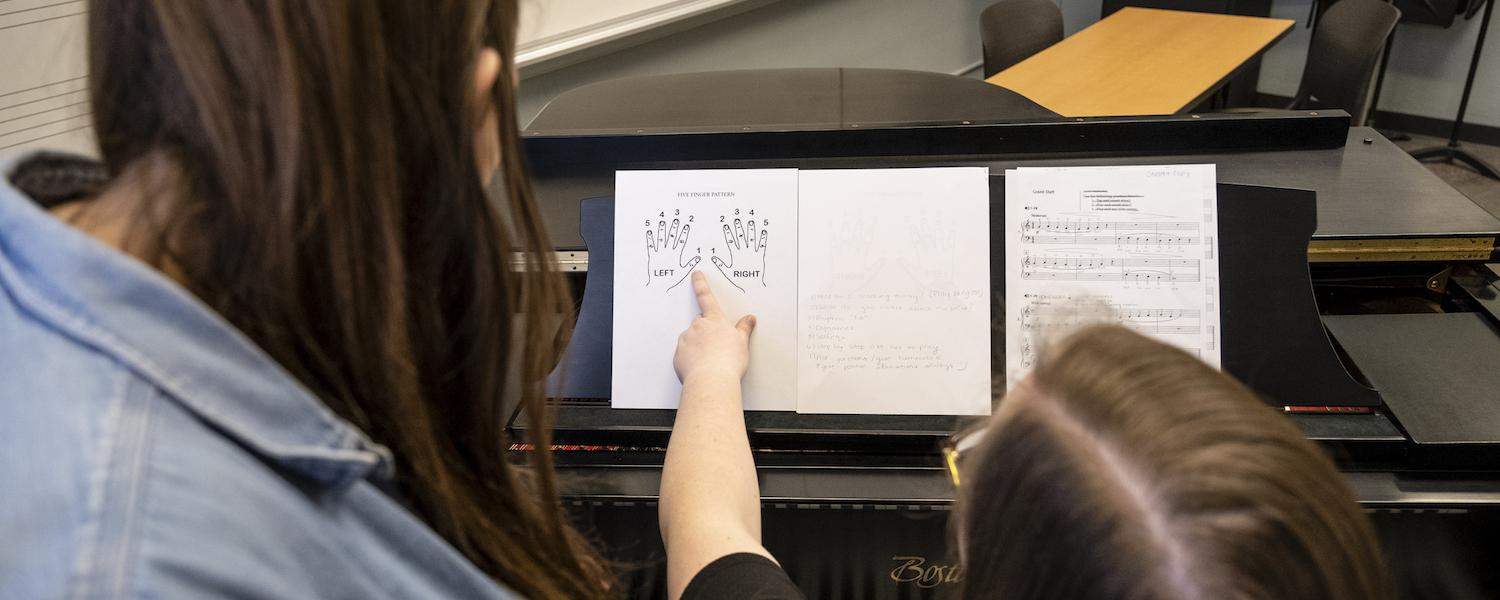 Music Education students working at the piano