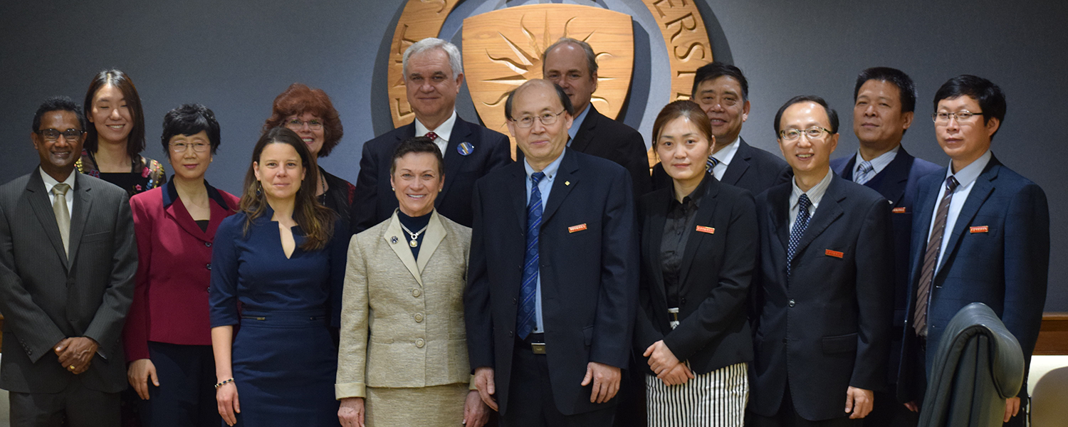 The delegations from both Kent State and XISU universities conclude their recent partnership signing ceremony.