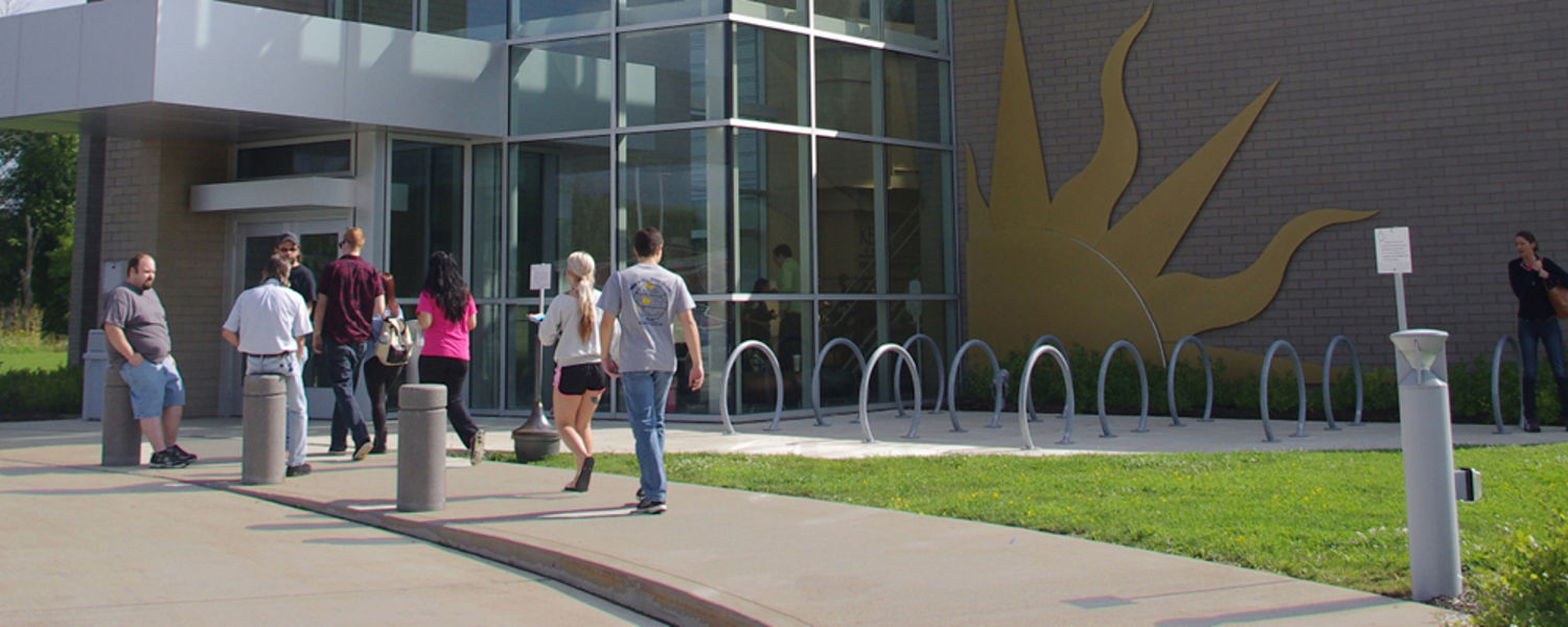 Students walking in front of building