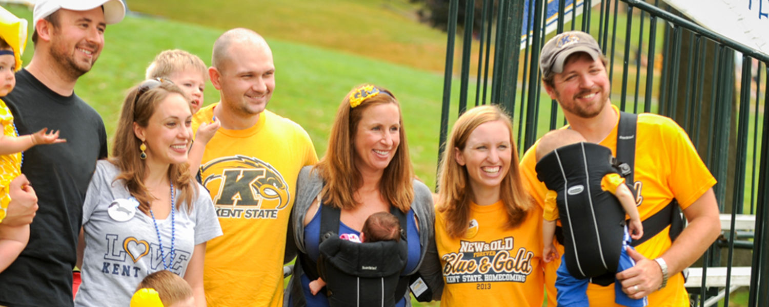 A family smiling at Parents & Families Welcome Weekend