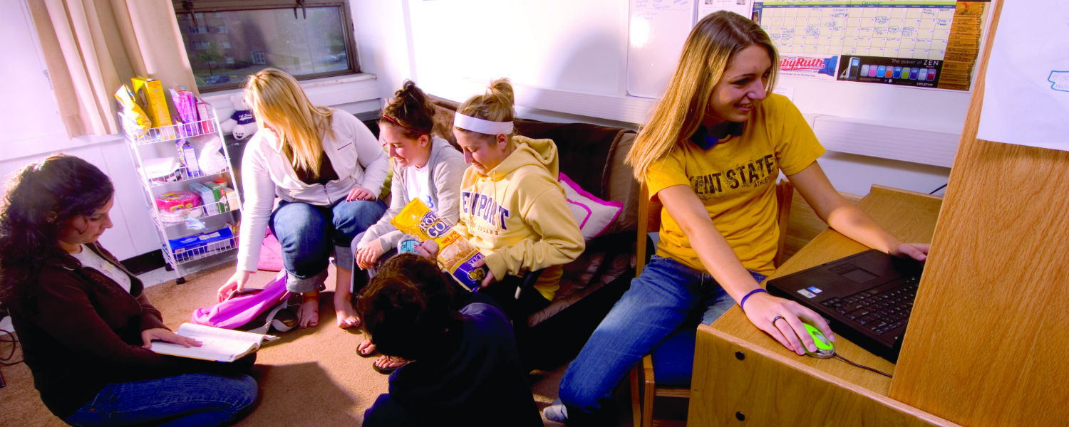 A group of students study together in their dorm room