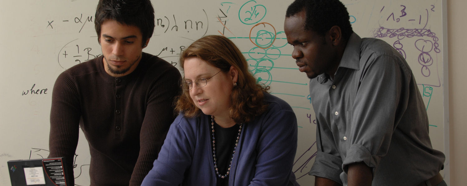 Dr. Robin Selinger , center, works with international graduate students Wilder Iglesias (Venezuela) and Badel Mbanga (Cameroon) in her office at the Liquid Crystal Institute.