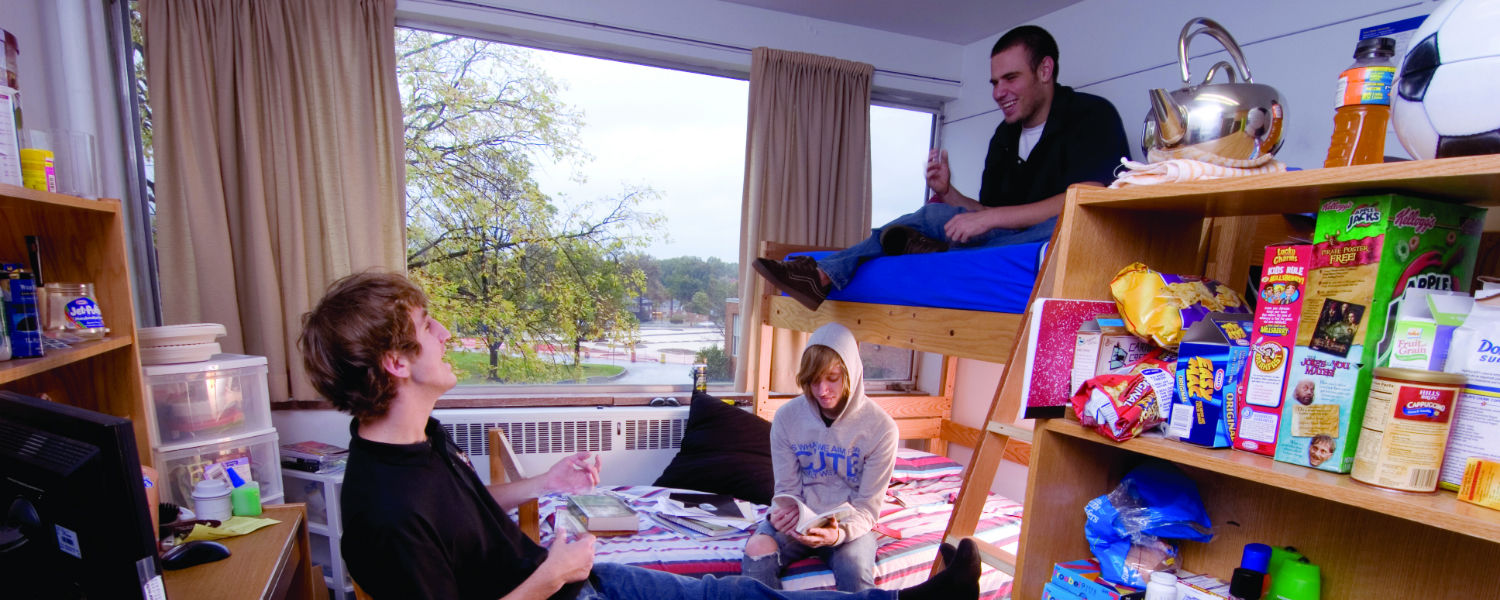 Students study together in a dorm room
