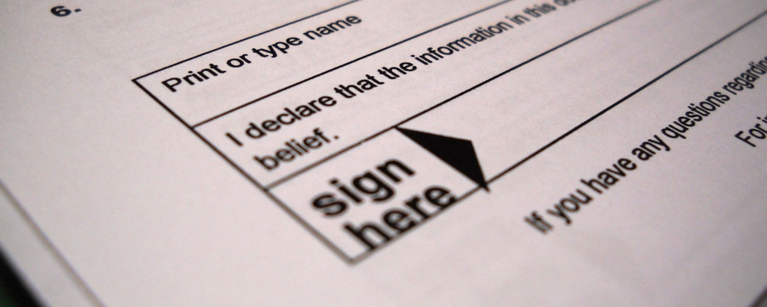 Sign here image