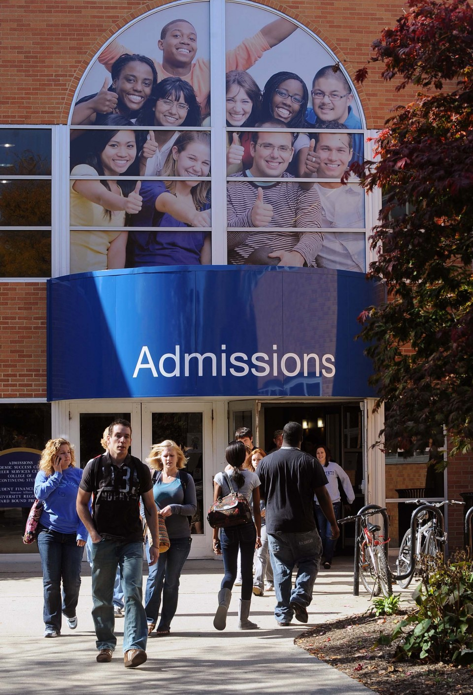 Students pass through the entrance of the Schwartz Center