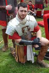 Trey De Falco posing in a Roman Legion-type uniform with shield
