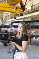 Jordan Redinger standing in Smithsonia Air and Space Museum