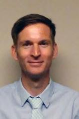 Headshot of Dr. Adam Lockwood.