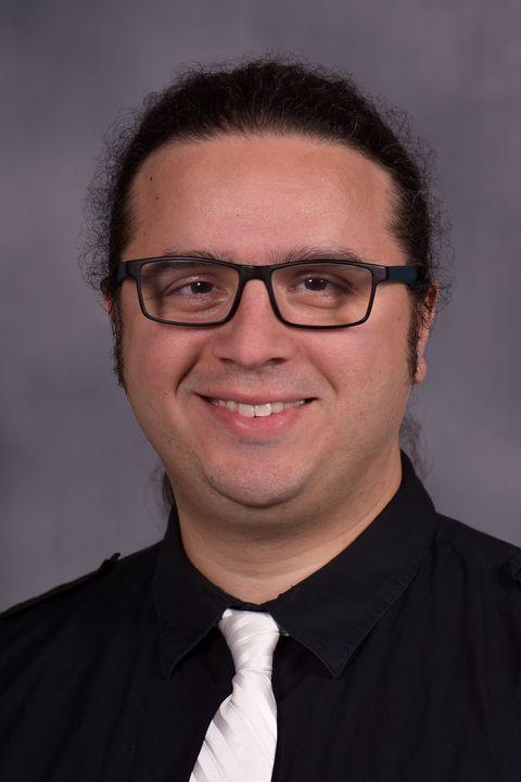 Headshot of Evren Koptur