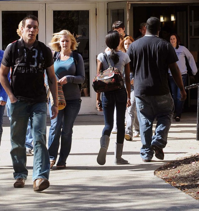 Students going in and out of the Michael Schwartz Center, where the Bursar's Office is located