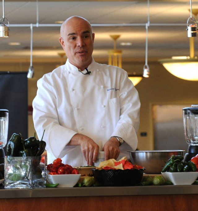 Celebrity Chef Roberto Santibanez prepares a dish in the Eastway dining room during a special appearance.