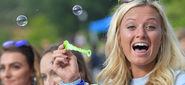 Girl blowing bubbles during KSU Kickoff