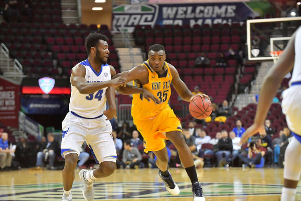 Kent State basketball drills down the court at a game.