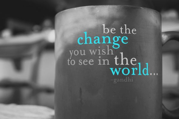 "Image of a coffee mug with the text ""be the change you wish to see in the world... ~ghandi"