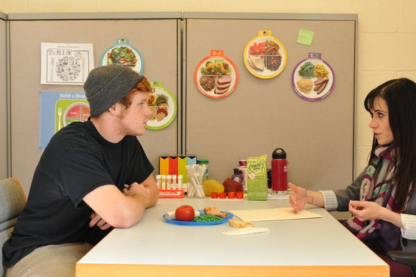 Tanya counseling a student on healthy eating