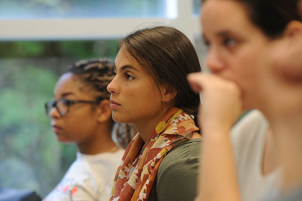 Students listen as their instructor provides a lesson on Fashion.