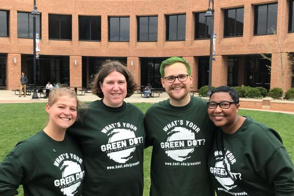 4 individuals wearing Green Dot shirts