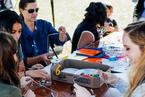 Kent Creativity Festival 2017 participants creating a wire community quilt