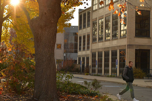 Students walk between Risman Plaza and the University Library.