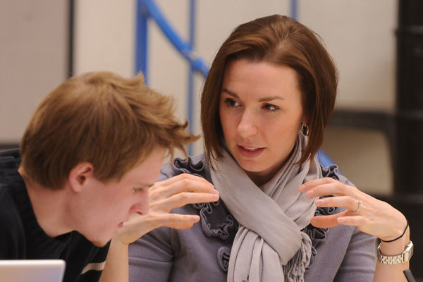 A student gets feedback from an instructor.