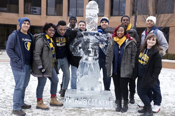 Students gather around an ice sculpture of Flash