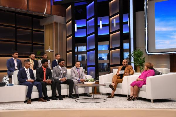 """Steve Harvey shares a joke with the eight scholarship recipients who will be attending Kent State this fall as Sonya Williams (far right) from the Division of Diversity, Equity and Inclusion looks on. (Photo provided by the """"Steve"""" television show)"""