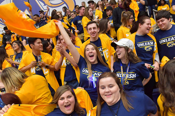 Kent State students rip their yellow shirts open to reveal blue #UNLEASH shirts.