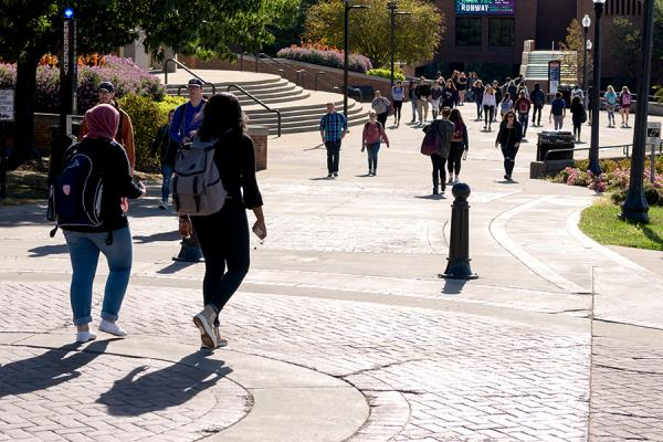 Students walk along the Lester A. Lefton Esplanade on the Kent Campus