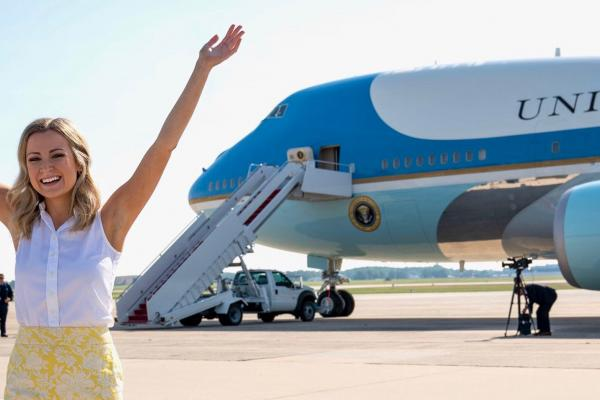 Sarah Matthews poses outside of Air Force One. She sometimes travels with the president in her role as Deputy Press Secretary.