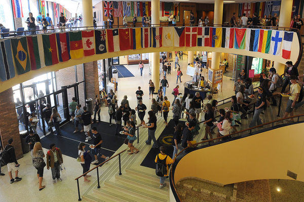 Flags representing the nations where incoming freshmen students are from line the interior of the student center.
