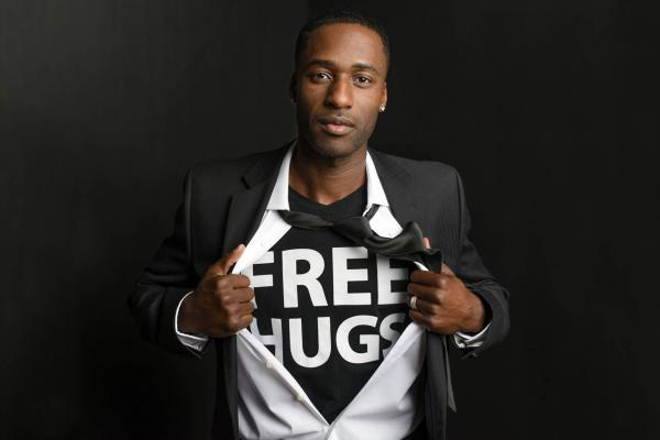 """Ken E. Nwadike, Jr is a documentary filmmaker, motivational speaker, and peace activist popularly known as the """"Free Hugs Guy."""""""