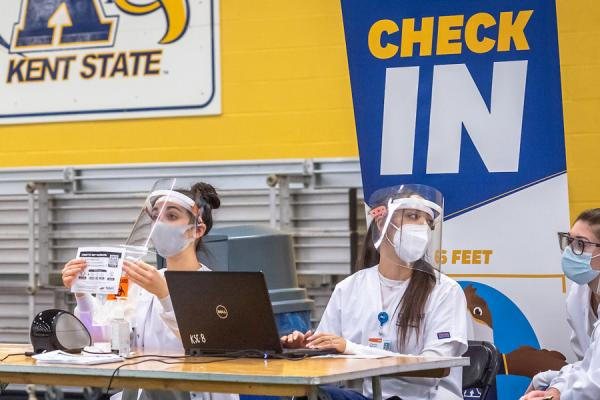 Nursing Students Check Students in at Fieldhouse Testing Event
