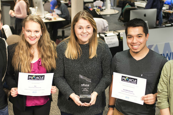 TV2 News Director Adam Kirasic, TV2 General Manager Anna Huntsman, The Kent Stater Editor Lydia Taylor, KentWired Digital Director Ray Padilla and The Kent Stater Managing Editor Jenna Kuczkowski pose with their awards.