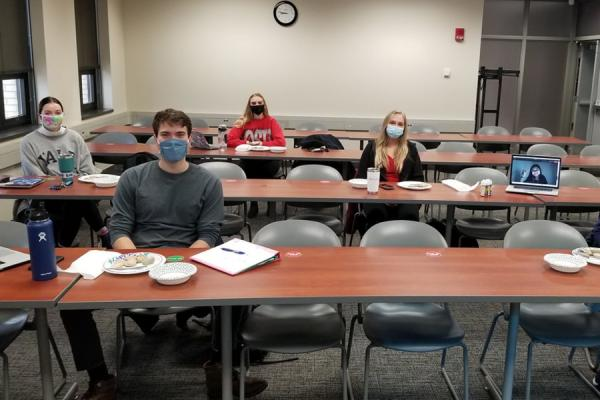 Students in masks with rocks